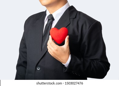 Man with a red heart in his hand.