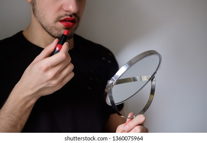 Man with a red lipstick on. Lips and beard close-up. Lgbt community. Transsexual guy. Transgender.