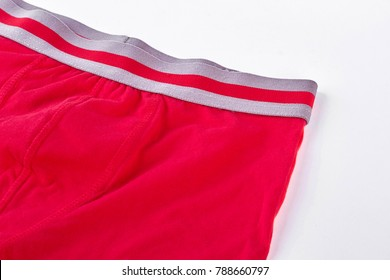 Man red pantie close up. Red cotton male pants isolated on white background. Brand undewear for men.