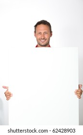 man in red shirt showing white board