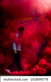 Man in red smoke grenade