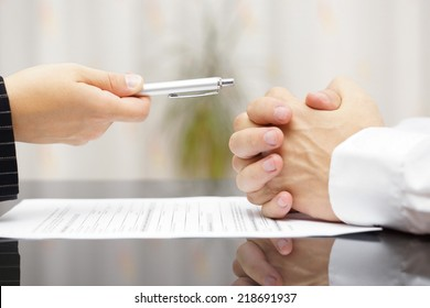 man refusing to sign a document