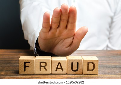 A man rejects the word Fraud with his hand. Countering deception, protection against fraudsters. The fight corruption, financial pyramids and business scams. War on crime. Cheaters