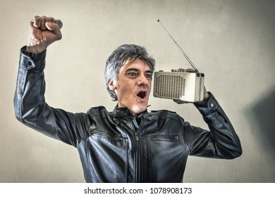 a Man rejoicing listening to radio