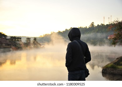 A Man Relax at The Riverside Village in Winter Season