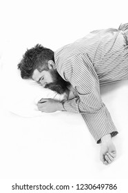 Man with relaxed face, lay on pillow, top view. Hipster with beard fall asleep. Fast asleep concept. Hipster drowsy, exhausted, copy space. Man with beard in deep sleep, white background.