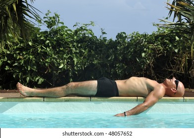 A man relaxed near swimming pool