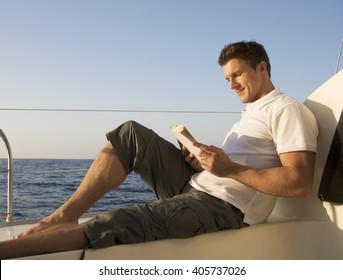 A man relaxing with a book on a boat