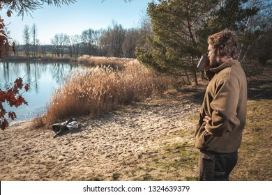 Man relaxing with a cup of coffee at a lake