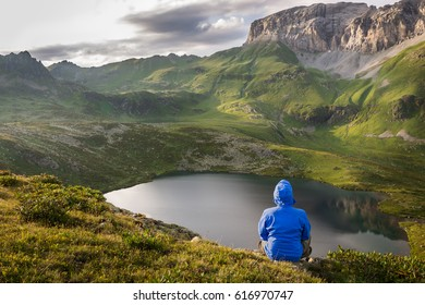Man relaxing and enjoying beautiful summer mountain landscape during his hiking trip. Travel concept lifestyle