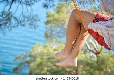 Man relaxing in a hammock on a beautiful sand beach. Cozumel, Mexico, Caribbean Sea.