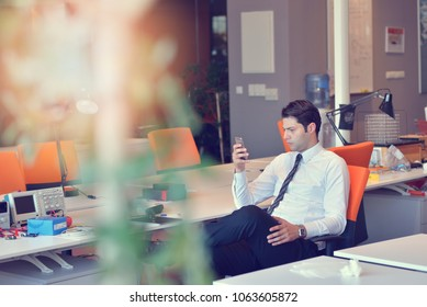 Man relaxing in his chair and enjoying the view from office window.