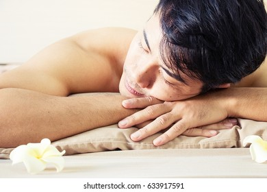 Man is relaxing with massaging in day spa