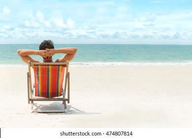 Man relaxing on the beach