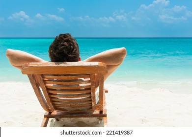 Man relaxing on beach, ocean view, Maldives island