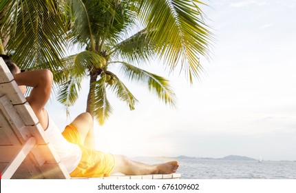 Man relaxing on beach on a sunny day. summer concept