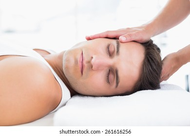 Man relaxing on massage table in medical office