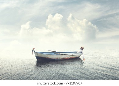 man relaxing on old boat floating in the calm water