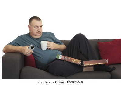 man relaxing on sofa with pizza box and remote control. The image is isolated with a clipping path.