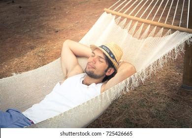 Man relaxing outside in a hammock