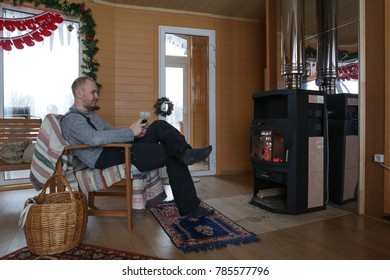 man relaxing and rest in wooden cottage with new year and Christmas decoration