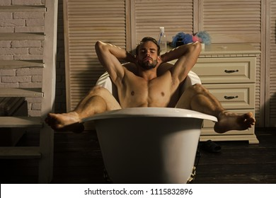 Man relaxing in spa bath. Bodycare, wellness, pleasure, relax. Man with muscular legs, chest, arms, biceps, triceps in bath. Bath bathing shower spa Hygiene grooming health