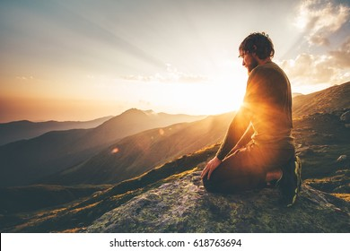 Man relaxing at sunset mountains Travel Lifestyle spiritual awakening emotional meditating concept vacations outdoor harmony with nature landscape