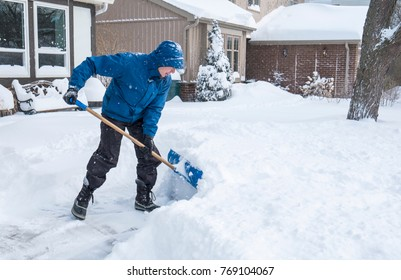 Man Removal Snow with a Shovel