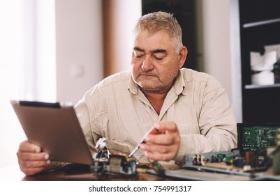 Man repair electronics