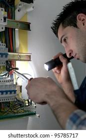 Man repairing electrical panel