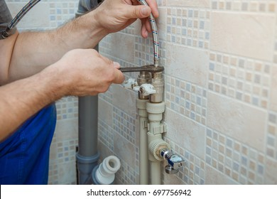 man repairing plumbing. Plumber.