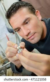 Man repairing a ring