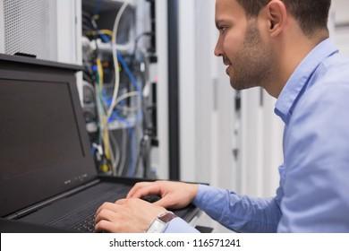 Man repairing servers in data center