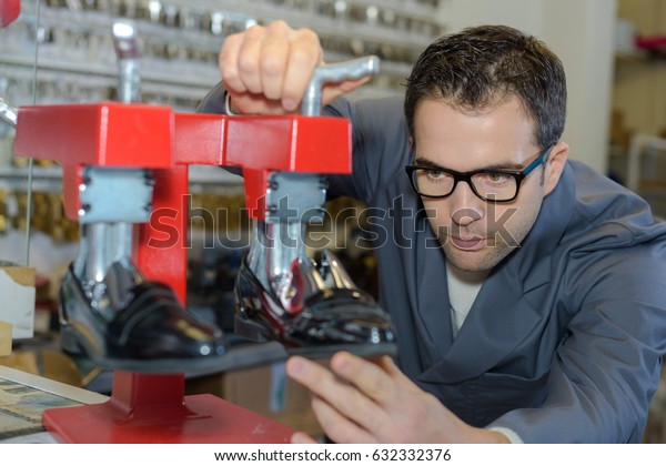 man repairing shoes