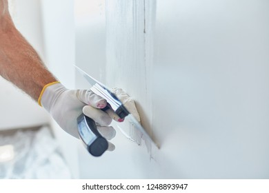 Man Repairing The Wall With Trowel
