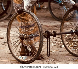 Man repairing a wheel of a traditional three wheelers isolated unique photograph