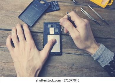 A man repairs a phone.