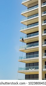 A man repels down a high-rise as he cleans the exterior. Seef, Bahrain July 1, 2017.