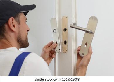A man Replacing a door handle
