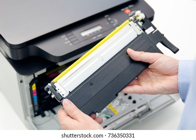 Man replacing toner in laser printer. toner printer cartridge print laser office supplies refill concept