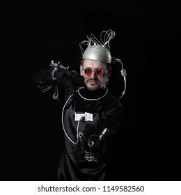 Man represents a crazy cyborg on square black background