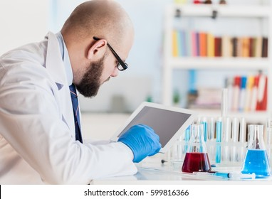 Man researcher carrying out scientific research.