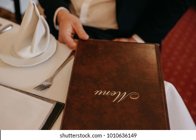Man in restaurant reading the menu