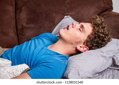 man resting on the couch during the day time