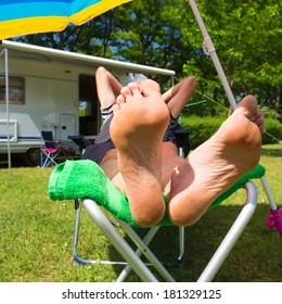 Man is resting in the sun at his mobil home