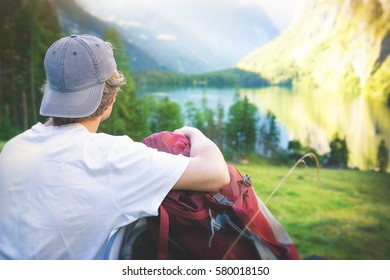 Man resting while looking at a stunning landscape.