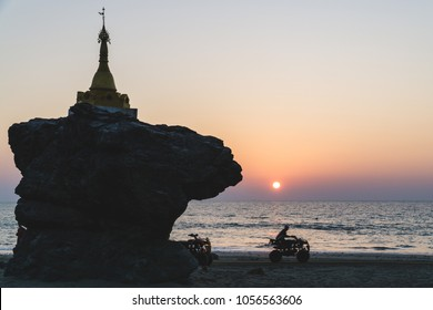 A man ride All terrain vehicle near twin pagoda on Ngwe Saung Beach, Myanmar