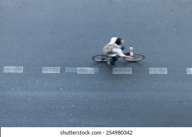 man ride bicycle in city road line motion blur top view