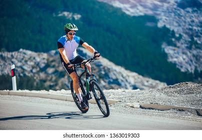 Man ride mountain bike on the road. Sport and active life concept.