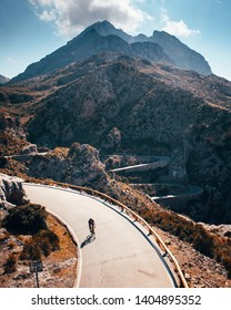 Man ride on bicycle in Famous Sa Calobra Climb in Mallorca Original sport wallpaper
